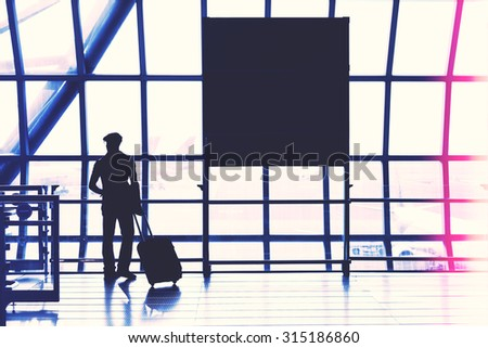 Silhouette of passenger in the Bangkok airport, interior of the airport. - stock photo