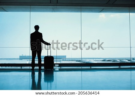 silhouette of passenger waiting in the airport - stock photo