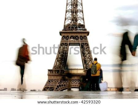 silhouette  of people in front of the Eiffel tower - stock photo