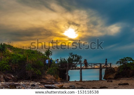 Silhouette of people walking on the mountain and bridge against vivid sunset sky,thailand - stock photo