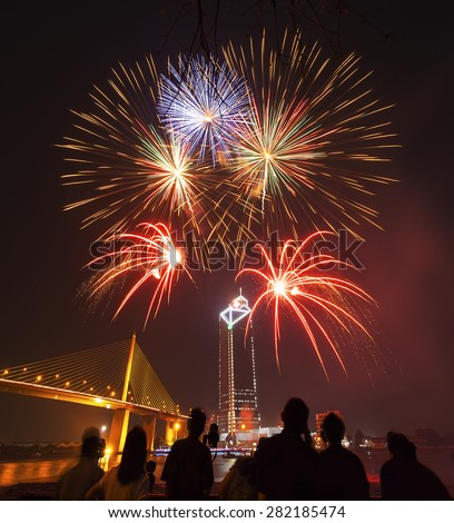 silhouette of peoples enjoy watching firework show in the night sky - stock photo
