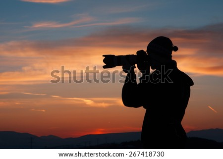 Silhouette of Photographer - stock photo