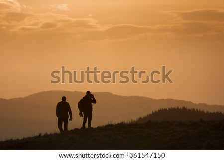 Silhouette of photographer on heal