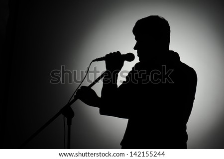 Silhouette of pop singer and presenter.