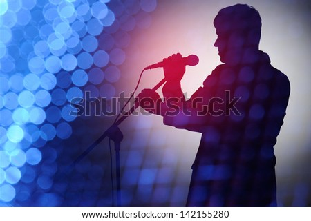 Silhouette of pop singer and presenter. - stock photo