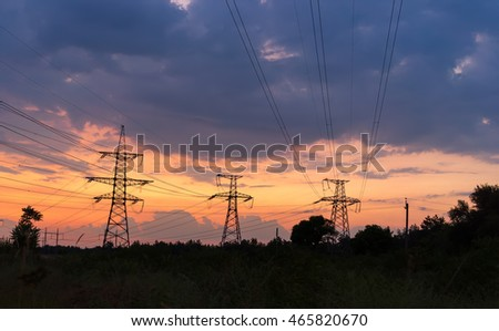 silhouette of power lines on sunset background.