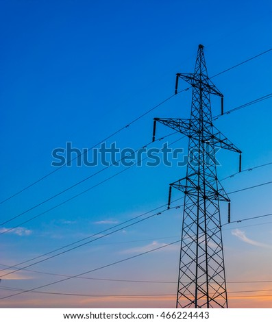 silhouette of power lines on the background of a beautiful sunset.