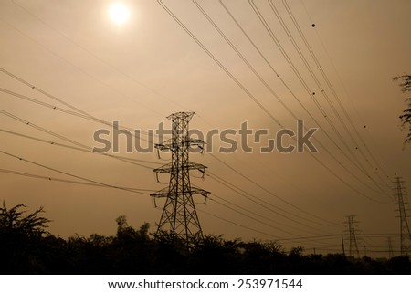 Silhouette of Power Tower at sunset - stock photo