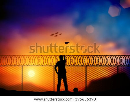 Silhouette of prisoner behind a barbed wire fence, throw paper airplanes to fight outside the barbed wire fence over blurred nature. Concept Freedom, dark tone multicolor light, independent thinking. - stock photo