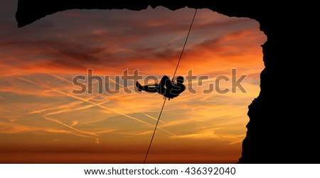 Silhouette of Rock Climber at Sunset panoramic view