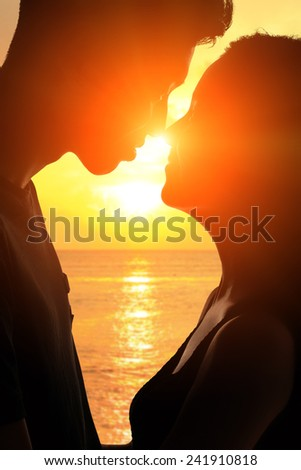 silhouette of romantic lovers hug with sea ocean in Maldives with sunset