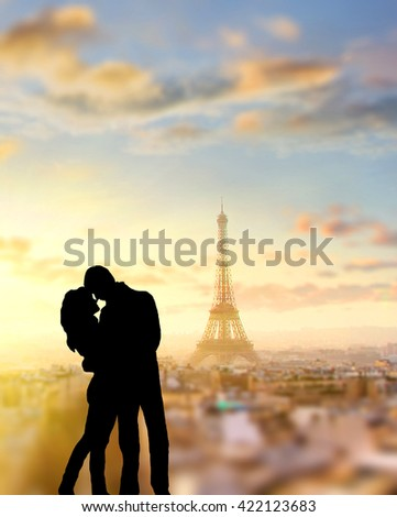silhouette of romantic lovers with eiffel tower on a background in Paris , France.