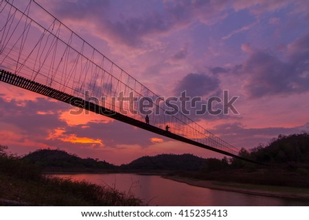 silhouette of rope bridge in the sunset time