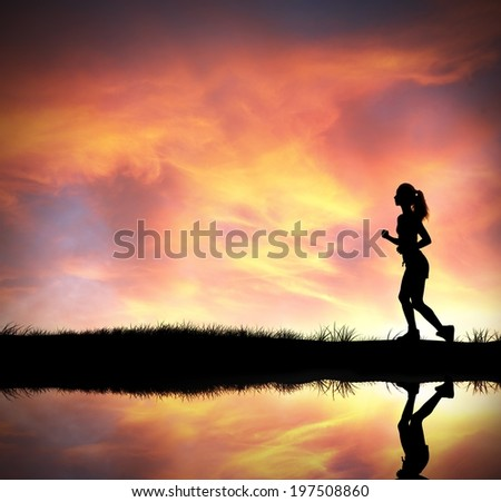 Silhouette of running girl at colorful sunrise
