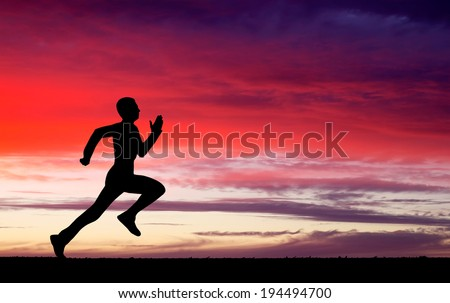 Silhouette of running man against the colorful sky. Silhouette of running man on sunset fiery background
