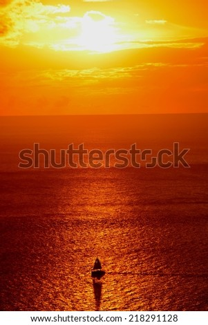 silhouette of sailing ship during caribbean sunset - stock photo