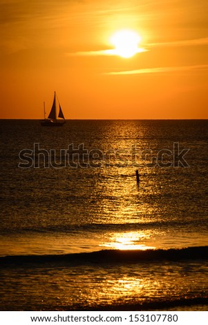 Silhouette of sailing ship in the Atlantic ocean, Fort Myers, Lee County, Florida, USA - stock photo
