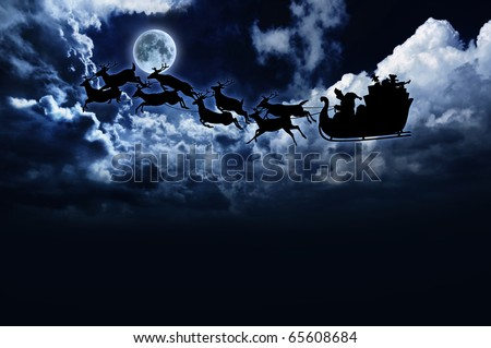 silhouette of Santa sleigh and reindeer in night sky with full moon - stock photo