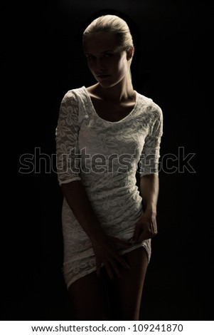 Silhouette of sexy blond girl isolated on white - stock photo