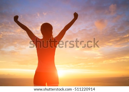 silhouette of sport woman feel free with sunlight