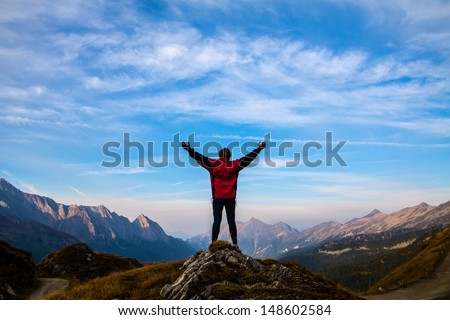 silhouette of sport women on the top of mountain - stock photo
