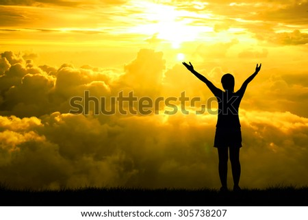 Silhouette of sport women open arms raised towards on hope sky at sunset light effect ,Concept for life achievements and success