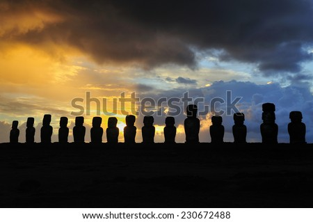 Silhouette of standing Moais at sunrise in Easter Island, Chile - stock photo