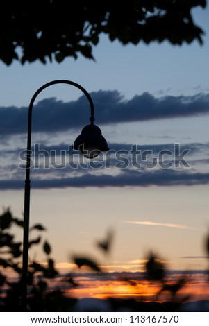 silhouette of street lamp in sunset