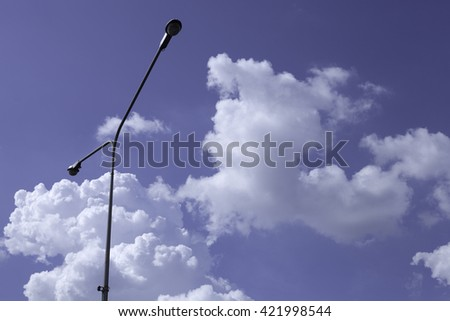 silhouette of streetlight with beautiful cloud sky background