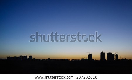 Silhouette of suburb under construction