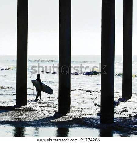 Silhouette of Surfer and Pier