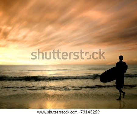 silhouette of surfer during sunset