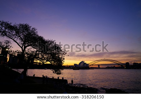 Silhouette of Sydney Opera House and Harbour Bridge during sunset - stock photo
