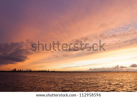 silhouette of tallinn with fire sea sunset