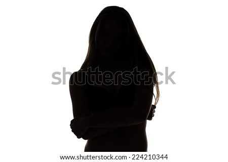 Silhouette of teenage girl with arms crossed on white background - stock photo