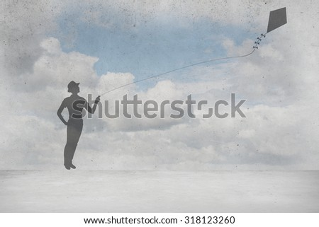 Silhouette of teenager girl playing with flying kite - stock photo