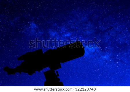 Silhouette of Telescope. Elements of this image furnished by NASA. - stock photo