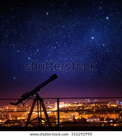 Silhouette of Telescope on background stars and night city. Elements of this image furnished by NASA. - stock photo