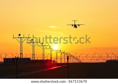 Silhouette of the airplane at the sunset  - stock photo