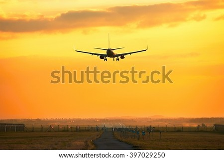 Silhouette of the airplane during landing at the airport