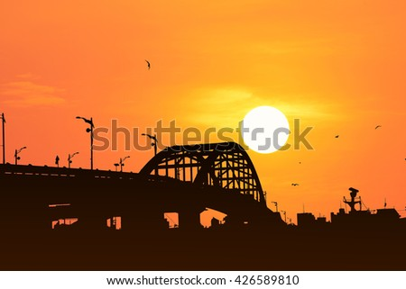 Silhouette of the bridge with beautiful sunset background.