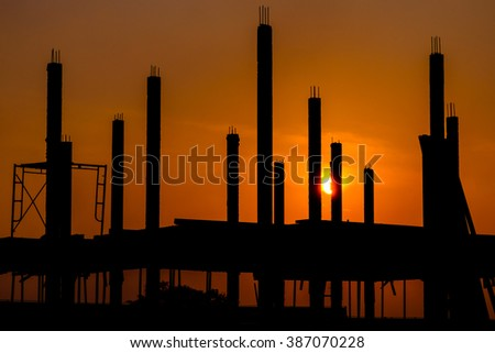 Silhouette of the building construction with sunset
