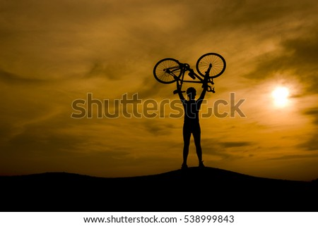 Silhouette of the cyclist riding a road bike at sunset.Mountain bicycle and man.Life style outdoor