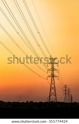 Silhouette of the high voltage towers at evening