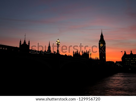 Silhouette of the Houses of Parliament on the river thames at dusk - stock photo