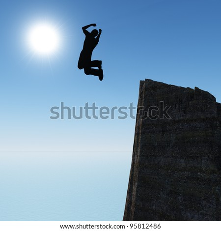 Silhouette of the jumping man from a rock. A shining sun with beams - stock photo