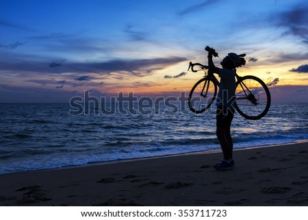 Silhouette of the man,drinking water with beautiful sea by at sunset