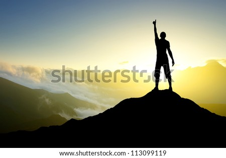 Silhouette of the person on the peak of mountain. Sport and active life