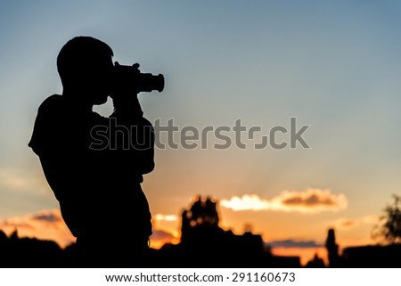 Silhouette of the photographer in beautiful sunset