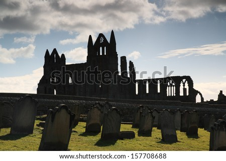 Silhouette of the ruins of Whitby Abbey North Yorkshire - stock photo